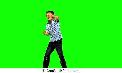 garçon, peu, vert, écran, danse