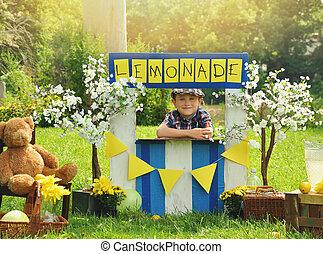 garçon, vendant citronnade, stand, jaune