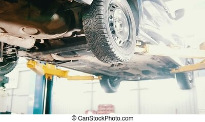 Garage automobile service - a mechanic checks the...