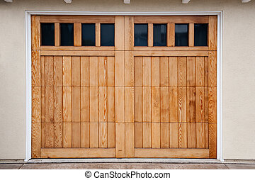 Garage Doors - Carriage style garage doors of a contemporary...