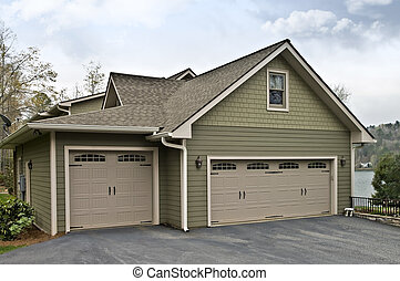 Garage Doors on a House - Side of a modern home showing the...