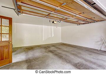 Garage interior with open automatic door