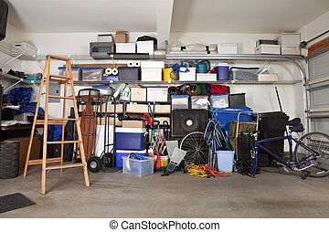 Garage Mess - Suburban garage mess. Boxes, tools and toys in...