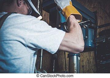 Garage Metal Works. Men and the Professional Grade Driller...