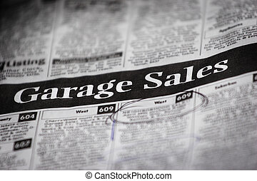 a newspaper with a garage sale heading (shallow depth of field)