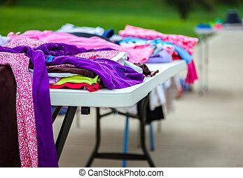 Garage sale - Clothes laid out on a table at a garage sale