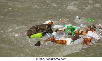 Garbage And Trash Floating In River Flow