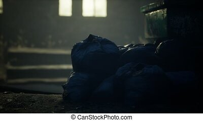 Garbage bags at city street an night