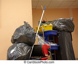 Blach garbage bags on janitor cart