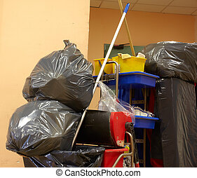 Garbage bags - Blach garbage bags on janitor cart