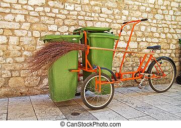 Garbage bike with broom.