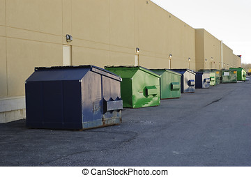 Garbage bin row - Blue and green industrial garbage bins...
