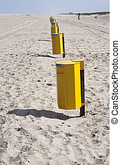 Garbage bins on the beach in the Netherlands
