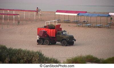 garbage car on beach - Car for garbage on beach