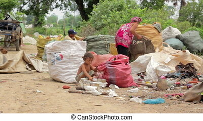 Garbage collector family in asian shanty