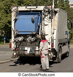 Garbage collector loading waste on the street