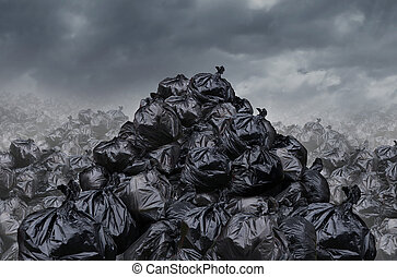 Garage dump concept with mountains of black waste bags of trash with an unpleasant smell in an infinite landfill heap landscape as a background of environmental damage issues on a foggy dark cloudy scene.