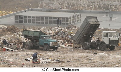 Garbage dump - Garbage machines unload garbage on a dump