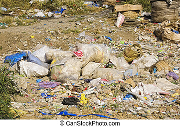 Sacks and sacks of refuse in a garbage dump