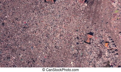garbage dump top view working people and bulldozers. Ukraine, the environmental problem of unsorted waste. High quality FullHD footage