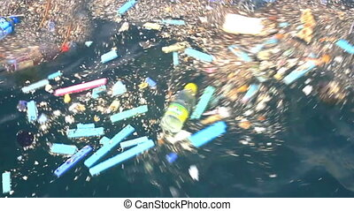 Garbage plastics floating in the sea. Floating garbage