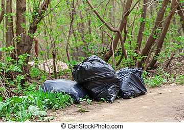 garbage in black plastic bags, cleaning streets