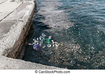 Garbage in water on pier.