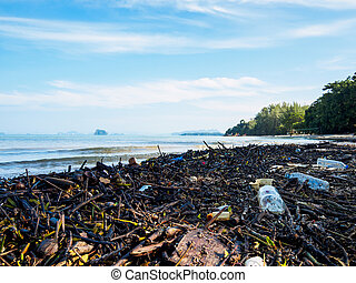 Garbage on a beach, environmental pollution of the sea...