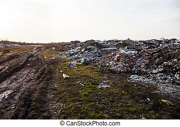 Garbage on the landfill near the dirt road