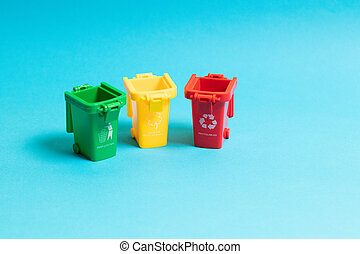 Care about ecology. 3 trash bins on blue background