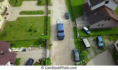 garbage transport car Aerial view, drone top view 4K UHD...