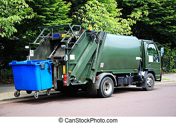 garbage truck - Green garbage truck with an elevated blue...