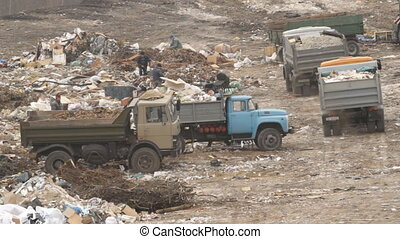 Garbage trucks on a dump