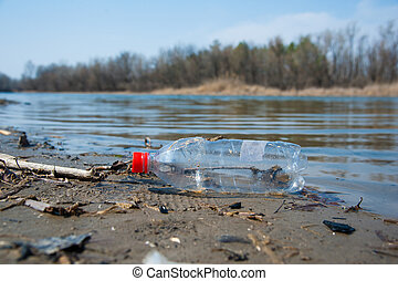 Garbage waste on the shore of a river
