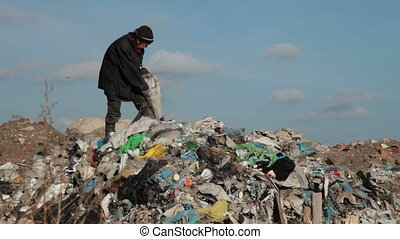 Garbage - woman working in the landfill