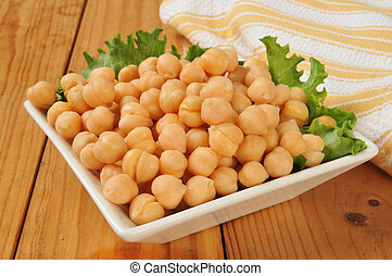 Garbanzo beans - A bowl of garbanzo beans with lettuce on a...