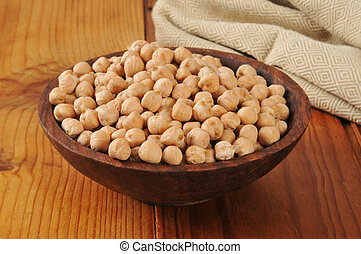Garbonzo beans - A wooden bowl of dried garbanzo beans