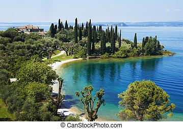 Garda lake resort in Italy - lake Garda in Italy. Bay and...