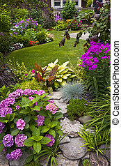 Garden and flowers - Lush landscaped garden with flowerbed ...