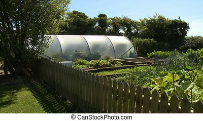 Garden and Greenhouse - Steady, exterior, medium wide shot...