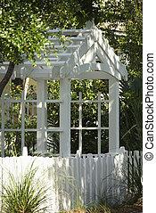 Garden arbor. - Garden arbor with white picket fence.