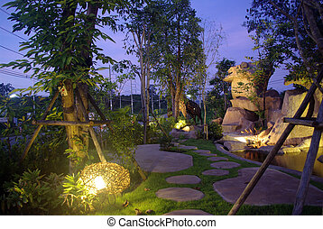 garden at night with waterfall