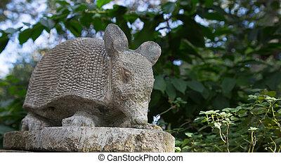 Garden baby Armadillo statue in the garden