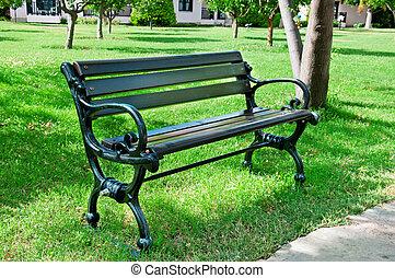 Garden bench in a summer park