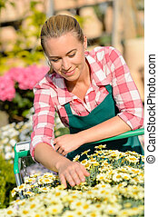 Garden center woman with flowers shopping cart
