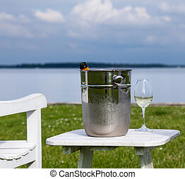 Garden chair and champagne by Chesapeake bay - Empty patio...