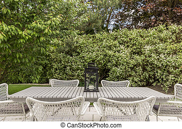 Garden chairs at wooden table