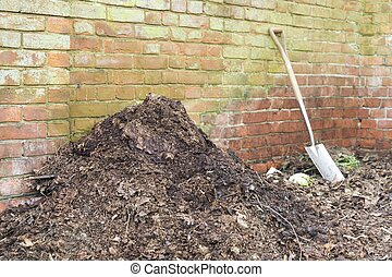 Garden compost heap with leaf mould, organic matter, UK