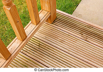 Corner profile of wooden garden decking a popular feature outside modern homes
