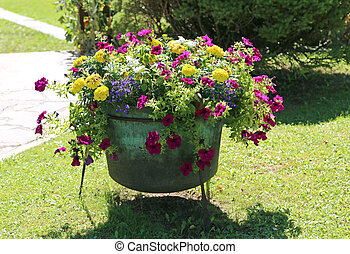 garden decorated with a cauldron like a vase of flowers